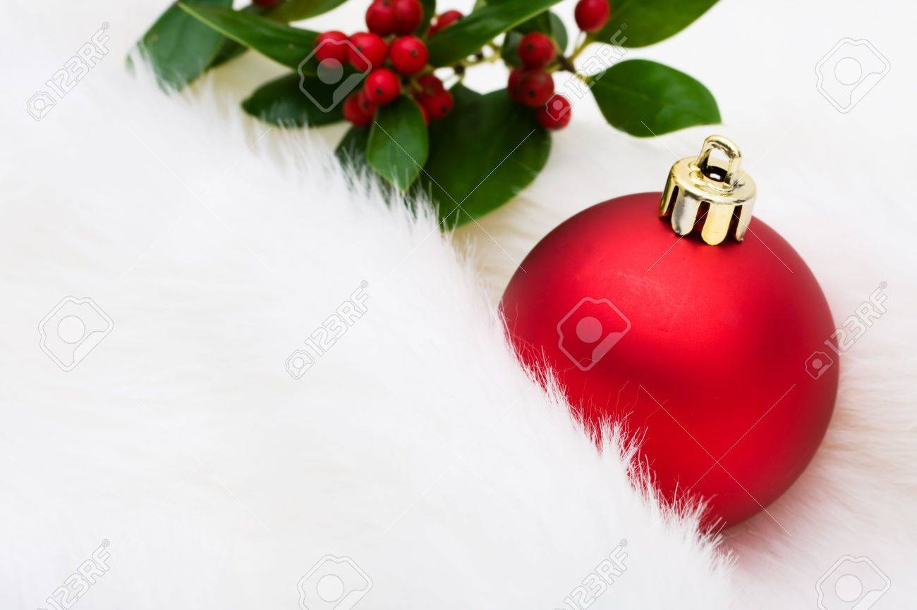 Red Christmas Ball Ornaments.Red Glass Christmas Ball Ornaments On A White Fur Background