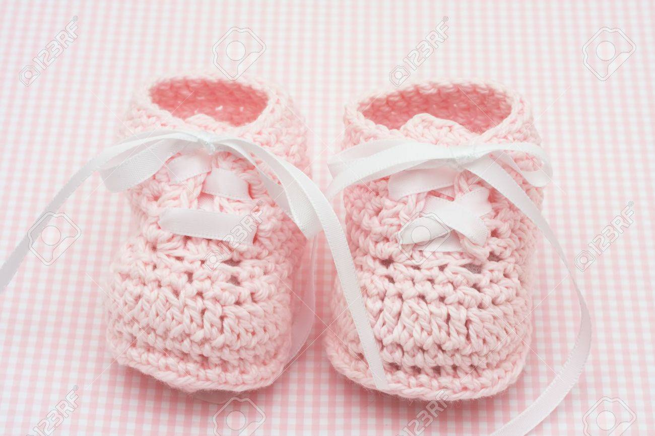 ca9dad6d78a Baby booties on a pink background, baby booties