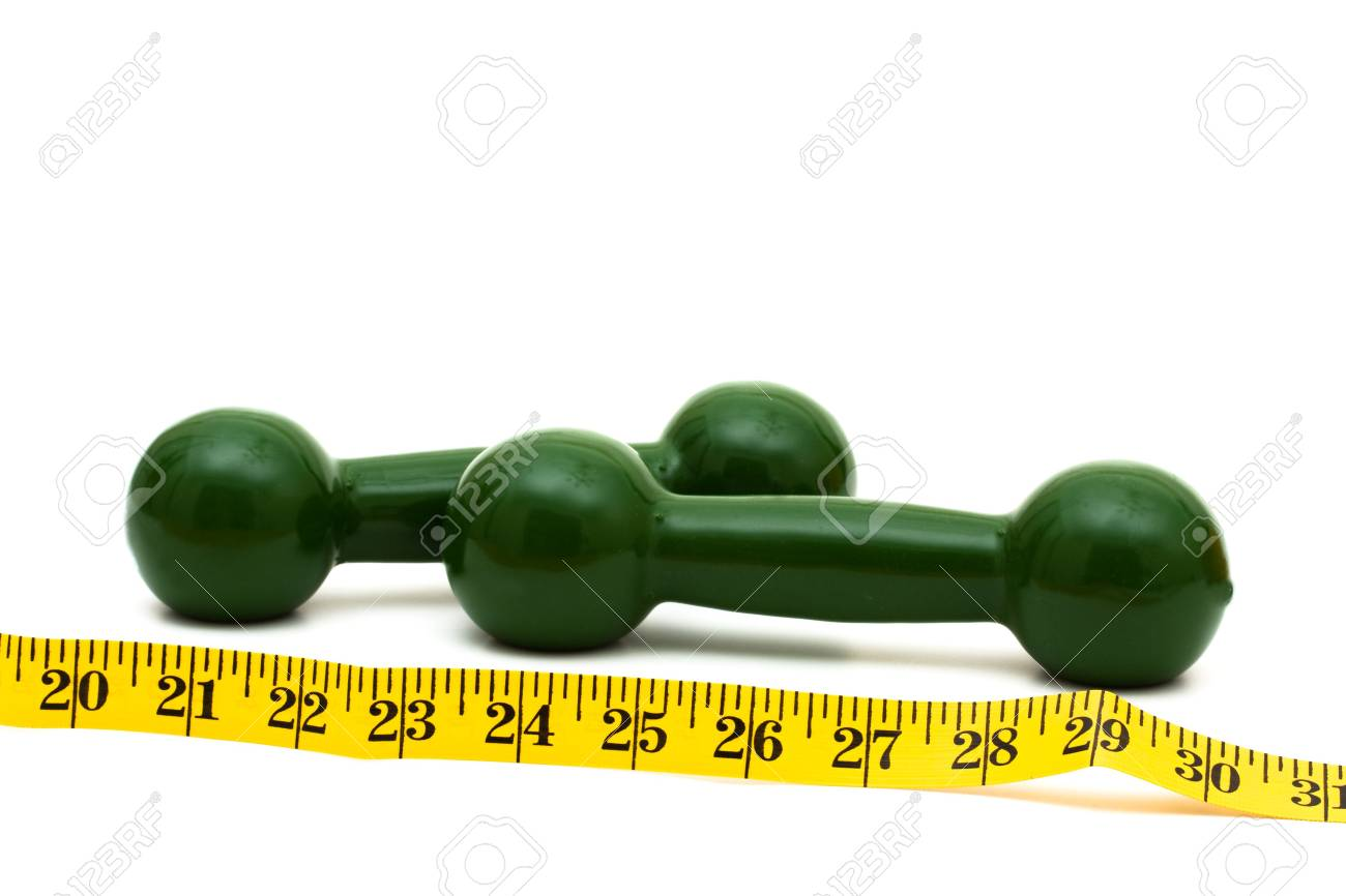 A measuring tape wrapped around a dumbbell with a white background, healthy living Stock Photo - 6269864