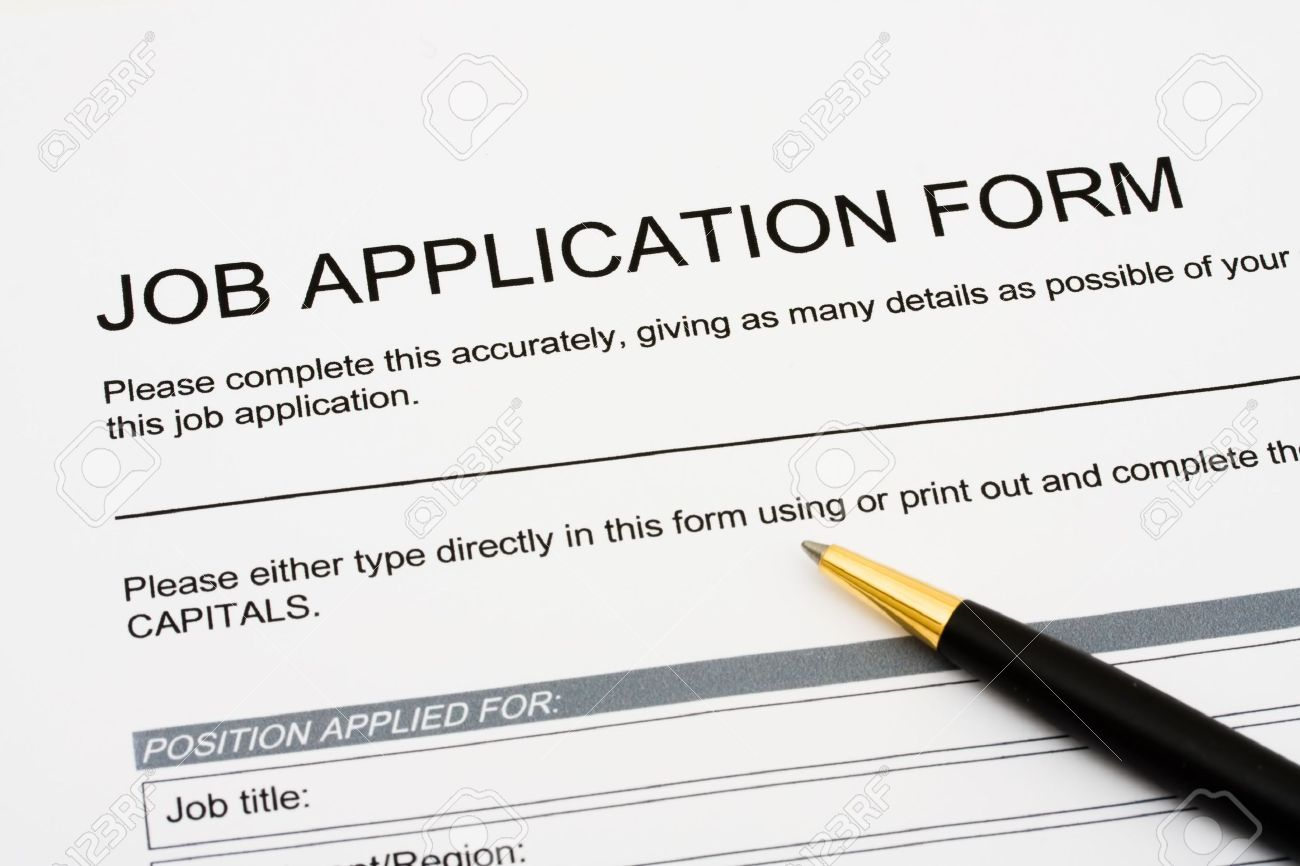 a job application jobs sitting a pen applying for a job a job application jobs sitting a pen applying for a job stock photo