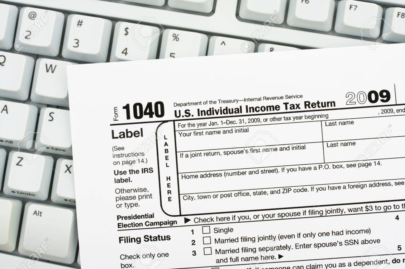 tax papers sitting on a computer keyboard file your taxes returns stock photo tax papers sitting on a computer keyboard file your taxes returns online