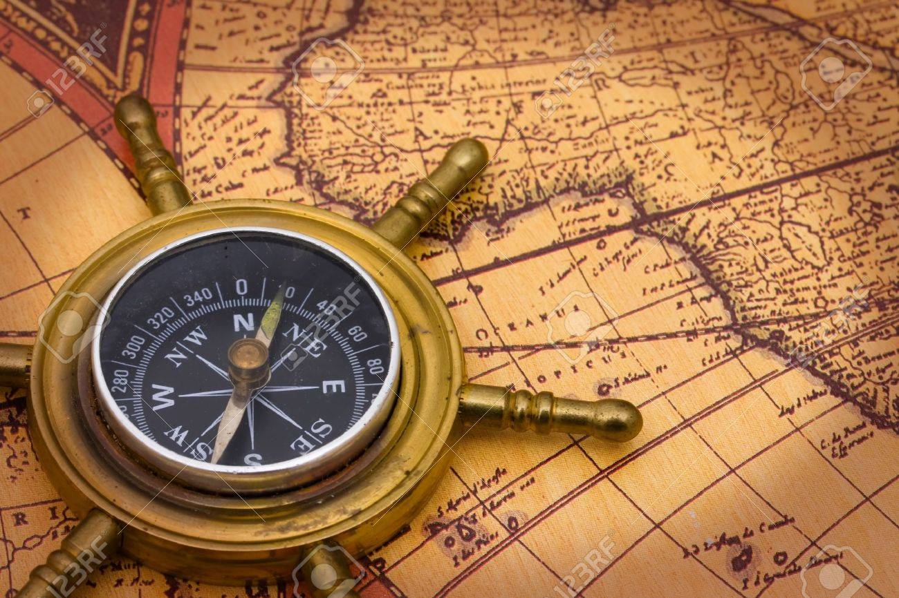 A compass on a old world map background stock photo picture and a compass on a old world map background stock photo 6847754 gumiabroncs Gallery
