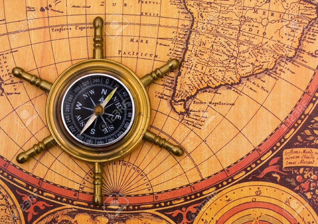 A compass on a old world map background stock photo 6866647