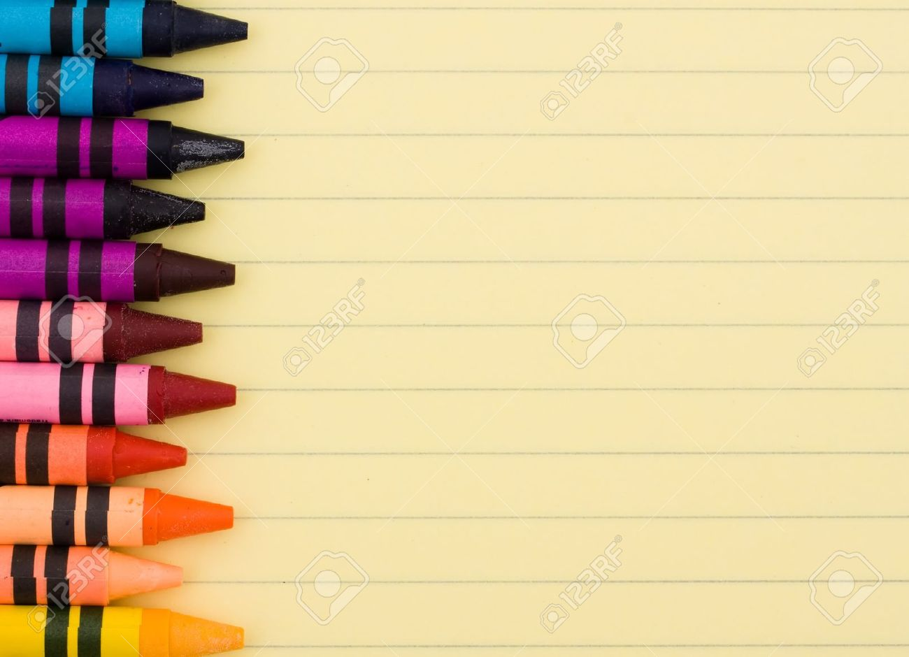 Colorful Crayons On A Sheet Of Lined Paper, Education Background ...