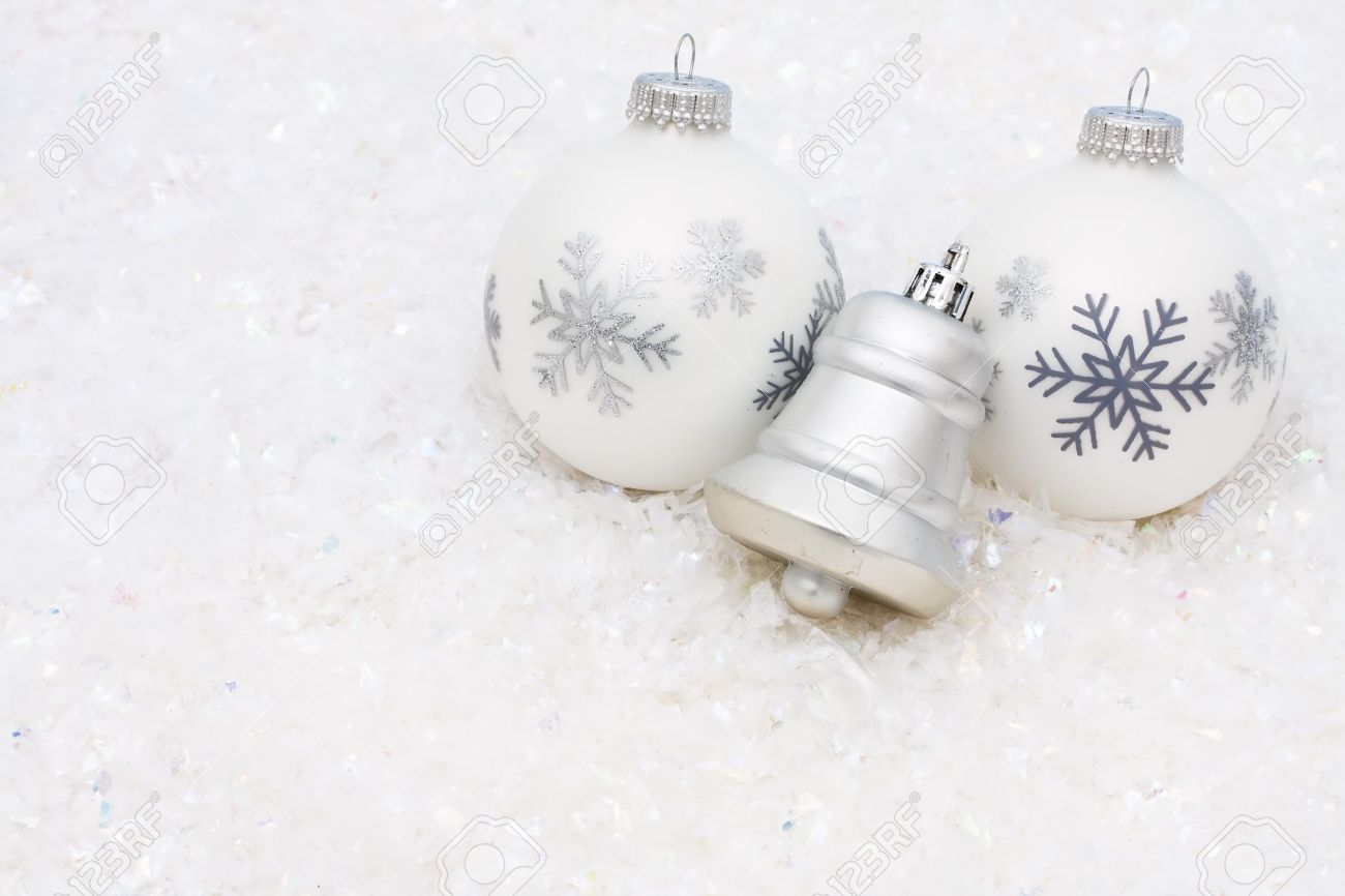 silver bell with christmas ornaments on a white textured background christmas time stock photo