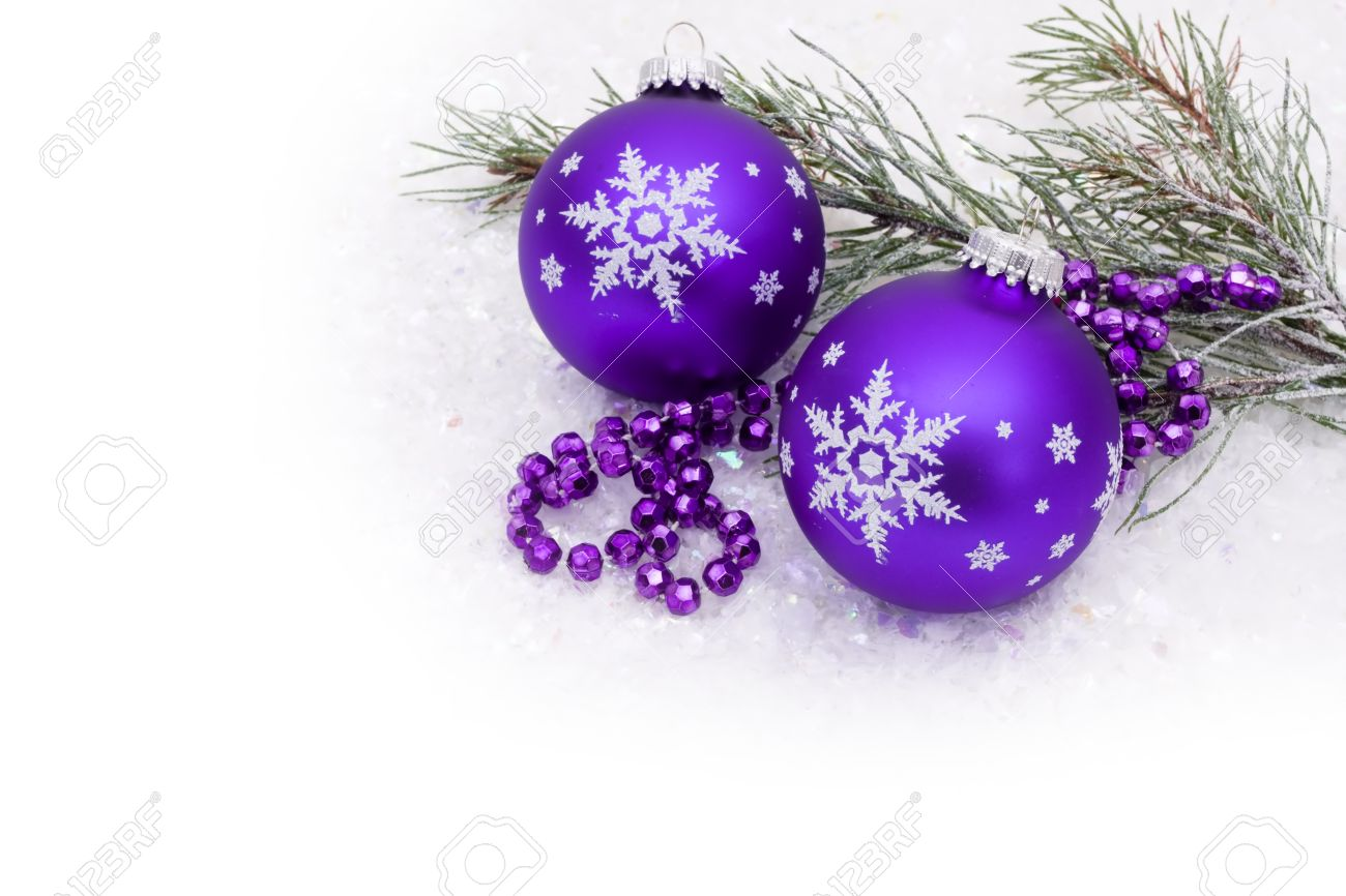 purple christmas ball on snow with a snow background christmas