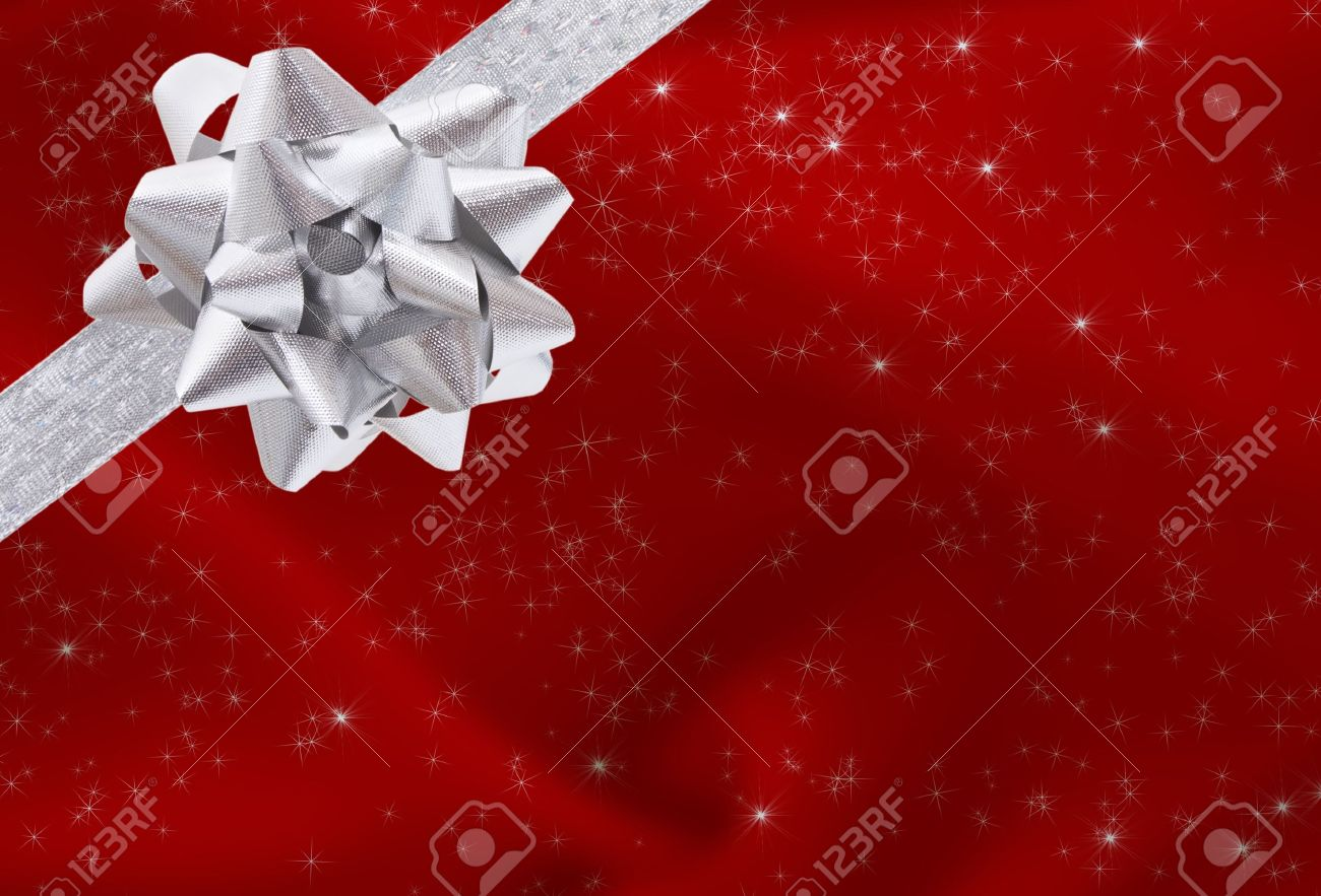 a ribbon and bow on a red background christmas present background stock photo 8366510