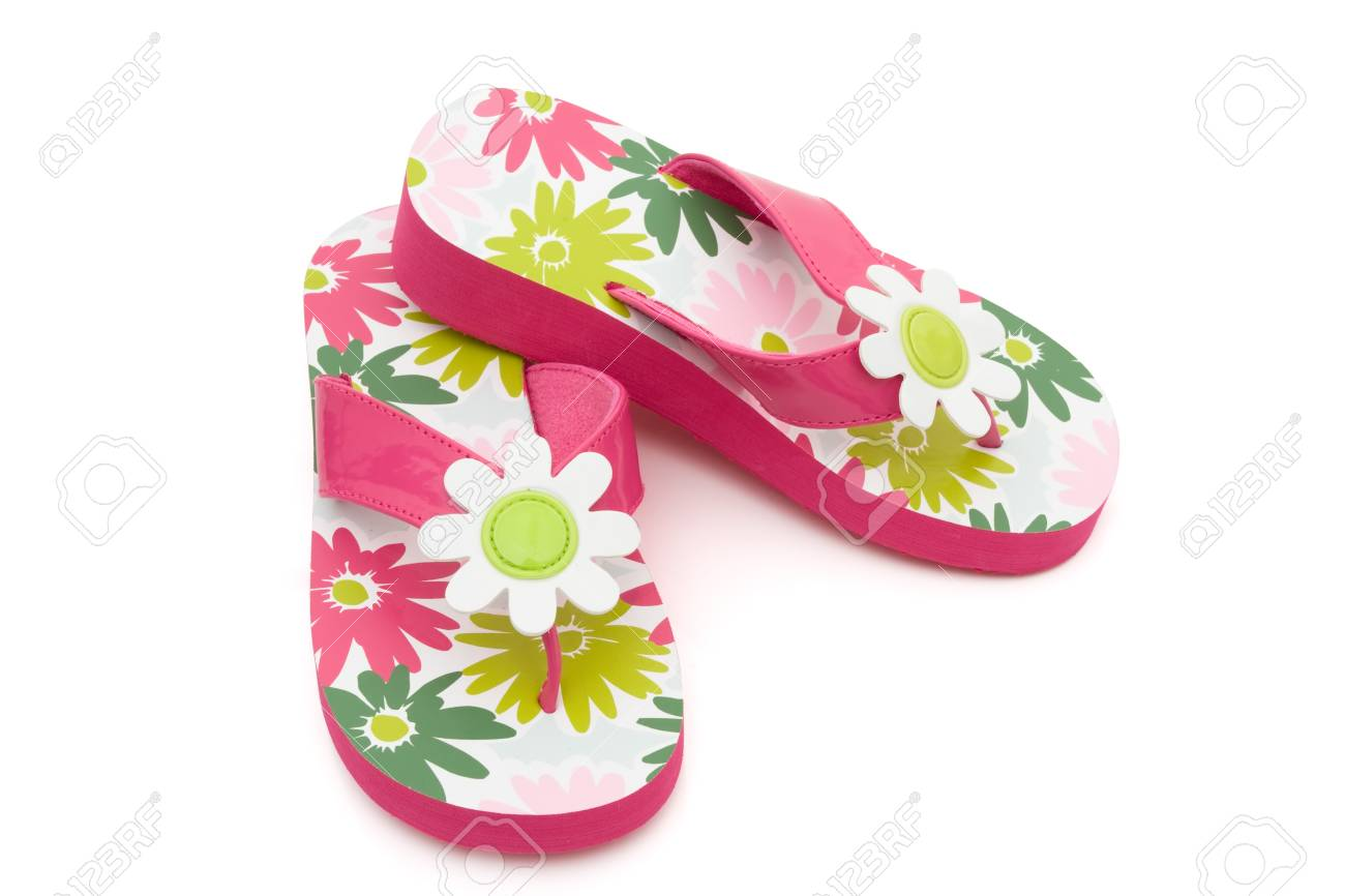 Pink Flowered Flip Flops On A White