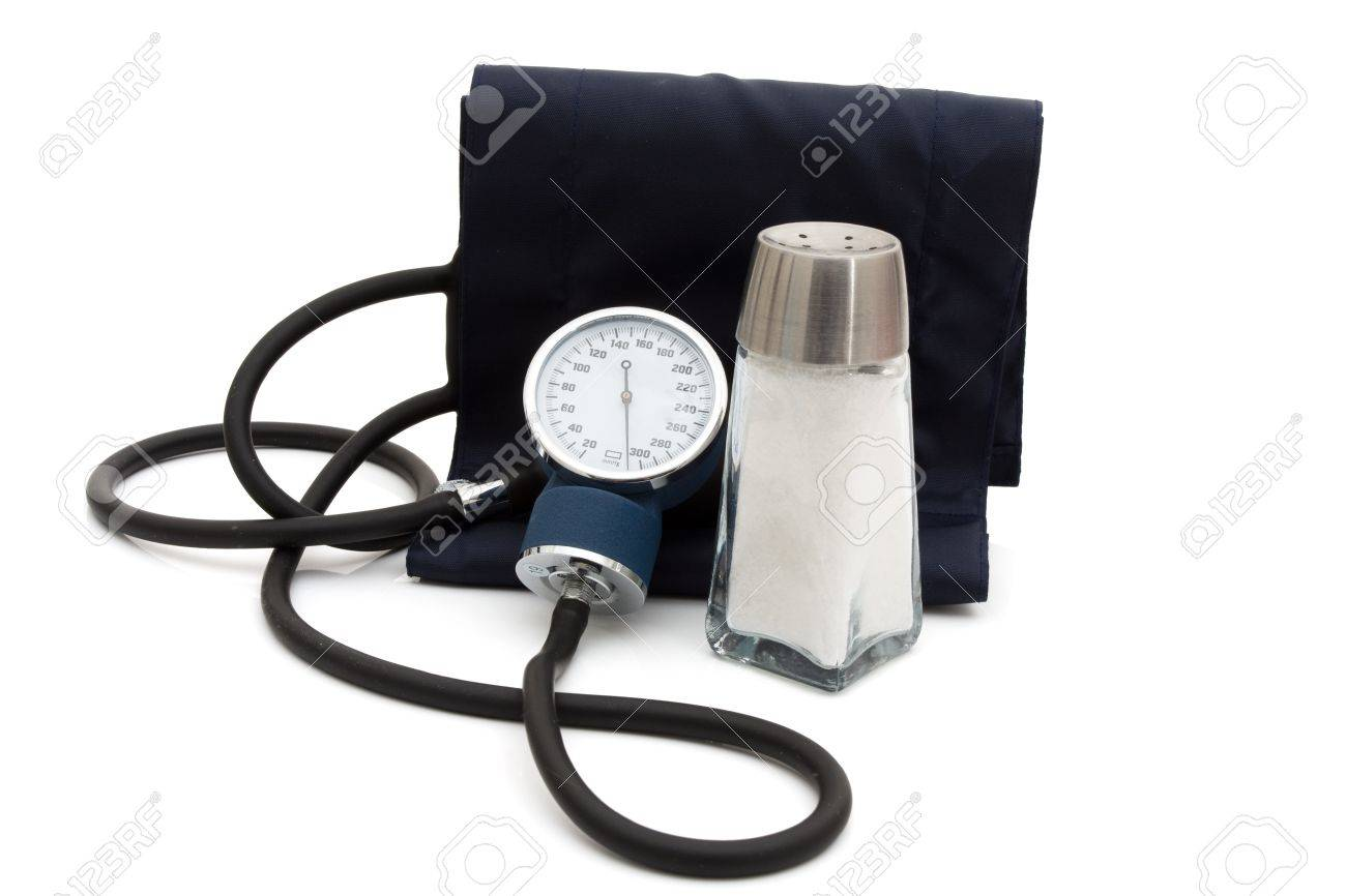 A blood pressure reading device, Sphygmomanometer isolated on white with a salt shaker Stock Photo - 9362685