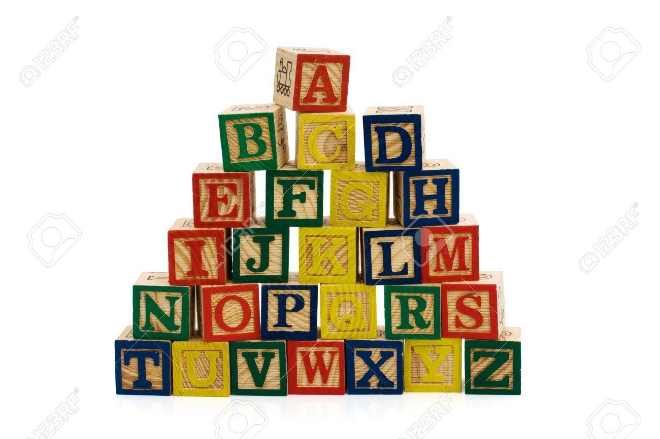 A stack to color wooden blocks of the alphabet isolated over white, Schools Days Stock Photo - 10031118