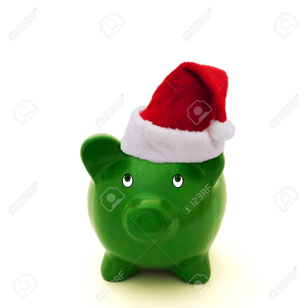 A piggy bank in a red Santa hat, Saving for Christmas Stock Photo - 11161687
