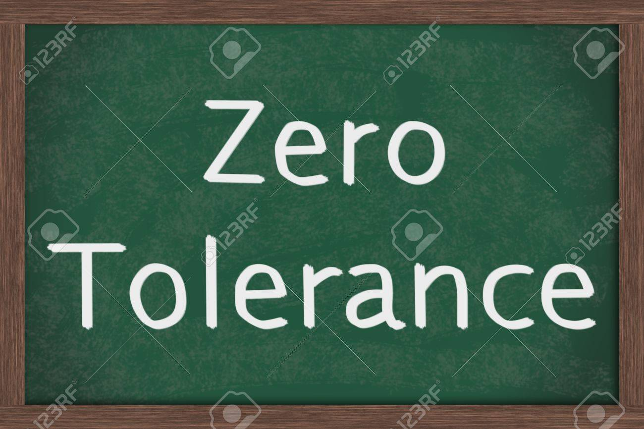 a chalkboard with the chalk letters zero tolerance zero tolerance
