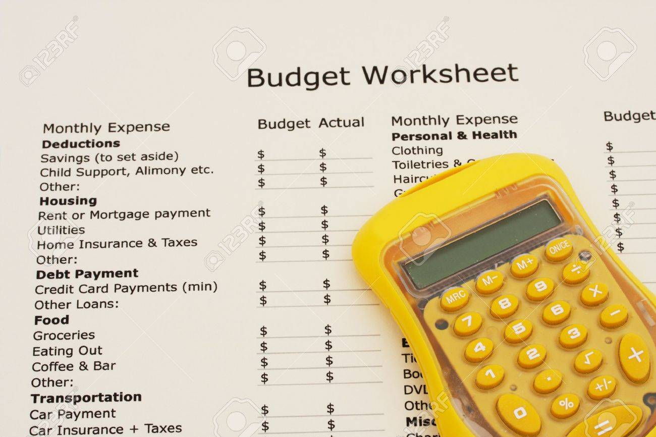 a budget worksheet with a calculator creating your budget stock