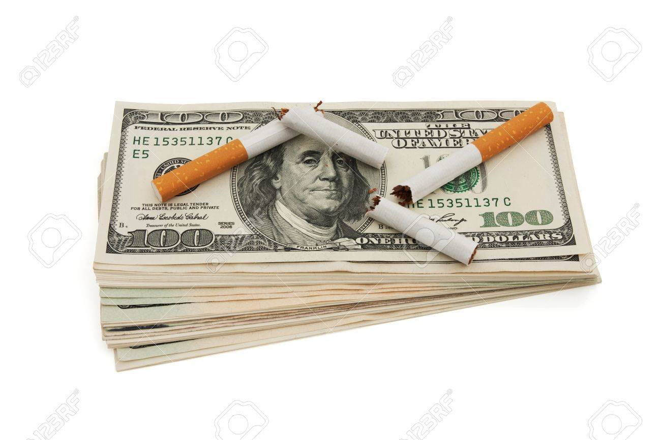 A stack of American money with a broken cigarettes isolated on white, The cost of smoking Stock Photo - 13125694