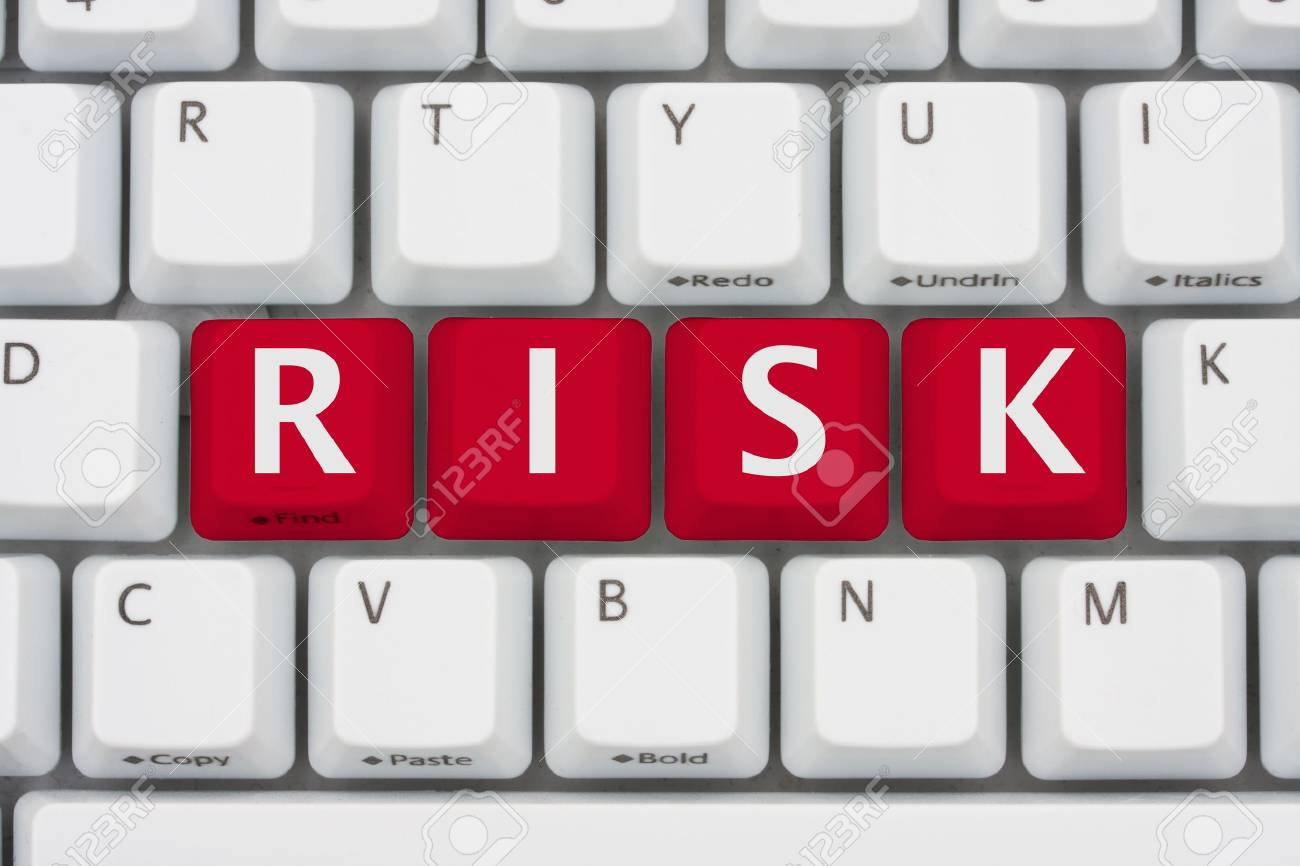A computer keyboard with red keys spelling risk, Risk of computer viruses, spyware and identity the theft Stock Photo - 13628769