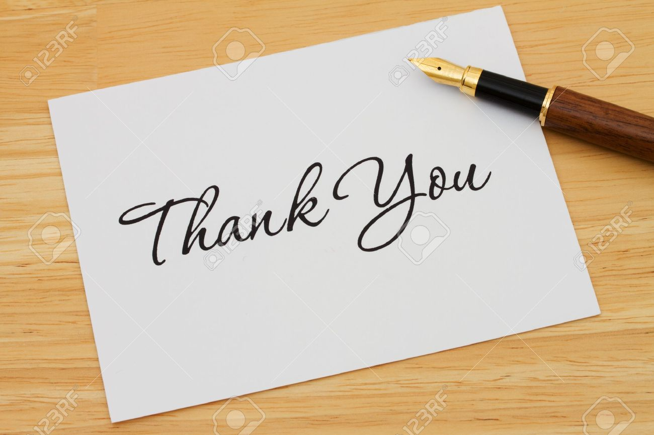 A thank you card with a fountain pen on a wooden desk, Writing a Thank You Note - 19447835