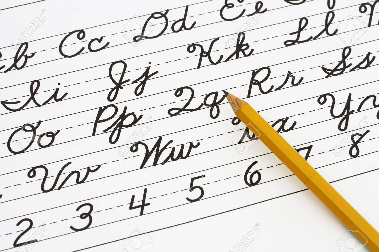 worksheet Learning Cursive example of cursive writing with a pencil learning stock photo 19447842
