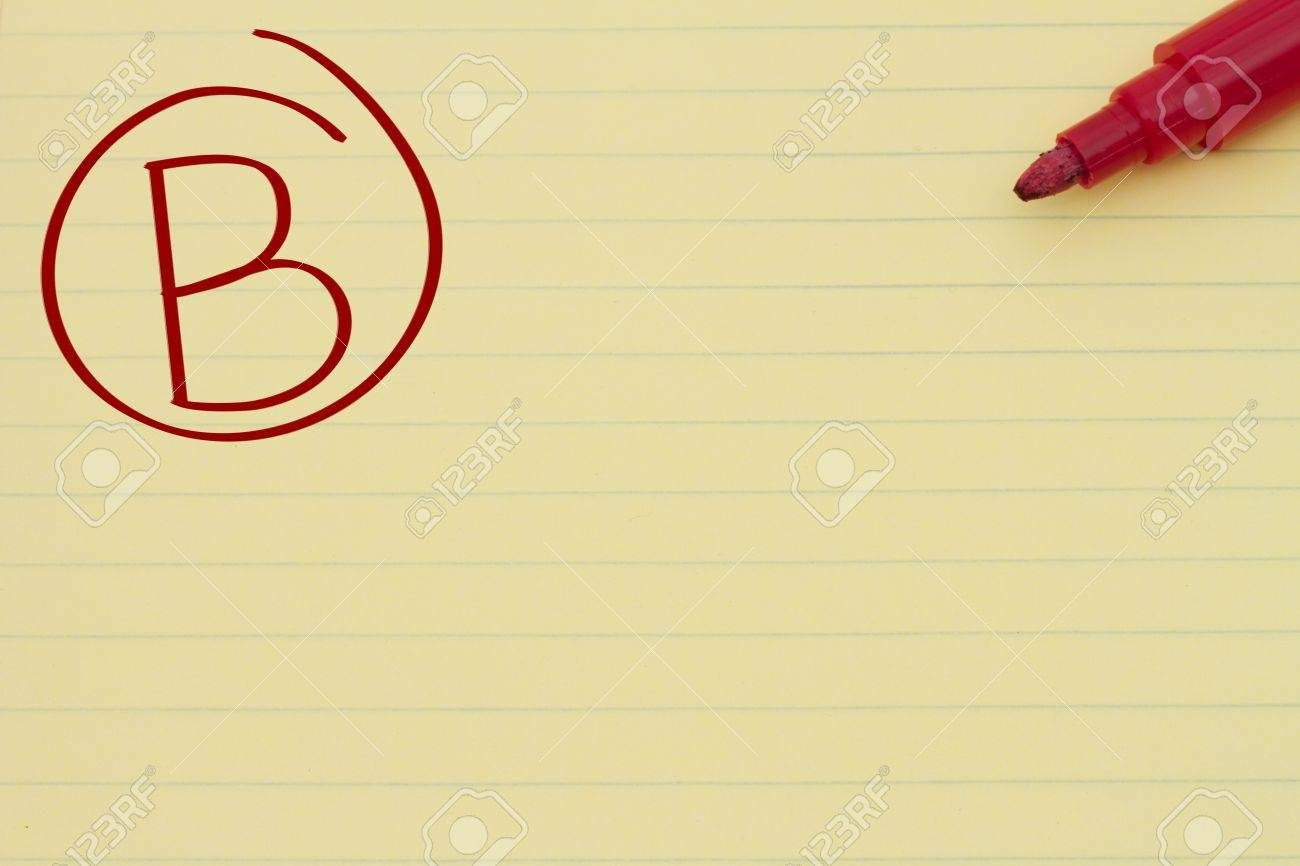 yellow lined paper the grade b in red circled and a marker stock photo yellow lined paper the grade b in red circled and a marker getting a good grade