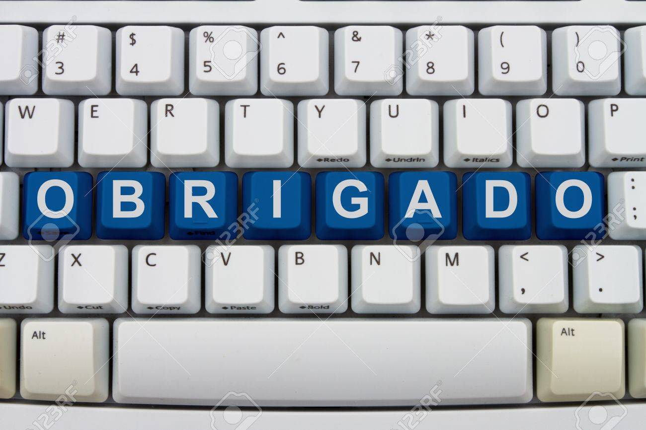 Computer keyboard keys with word Obrigado, Portuguese thank you, Obrigado for your online purchases Stock Photo - 20747897