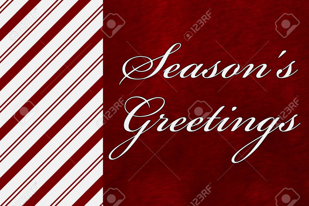 A seasons greetings card a candy cane stripes with words a seasons greetings card a candy cane stripes with words seasons greetings over red plush kristyandbryce Choice Image