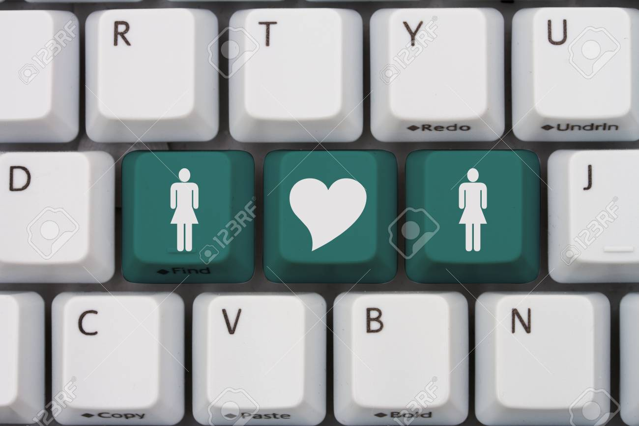Online dating a gray computer keyboard with woman and woman online dating a gray computer keyboard with woman and woman symbol with a heart in biocorpaavc Images
