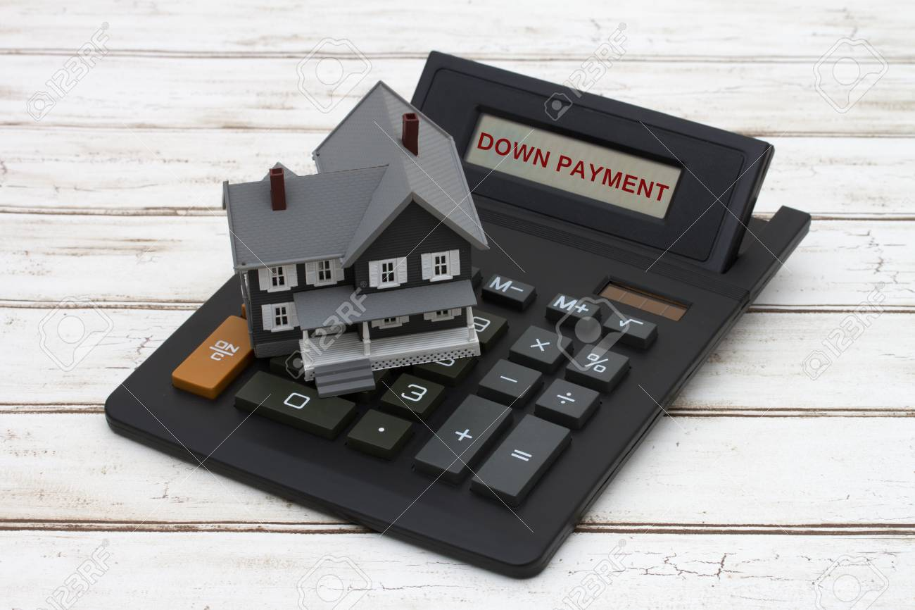 Down Payment Calculator >> Calculating Your Down Payment A Gray Model House On A Calculator