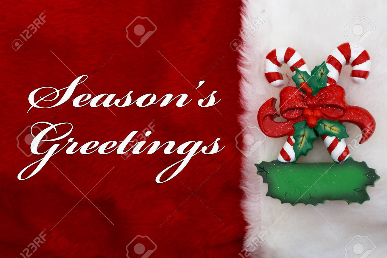 Seasons greetings a plush red stocking with a candy canes and seasons greetings a plush red stocking with a candy canes and words seasons greetings stock m4hsunfo