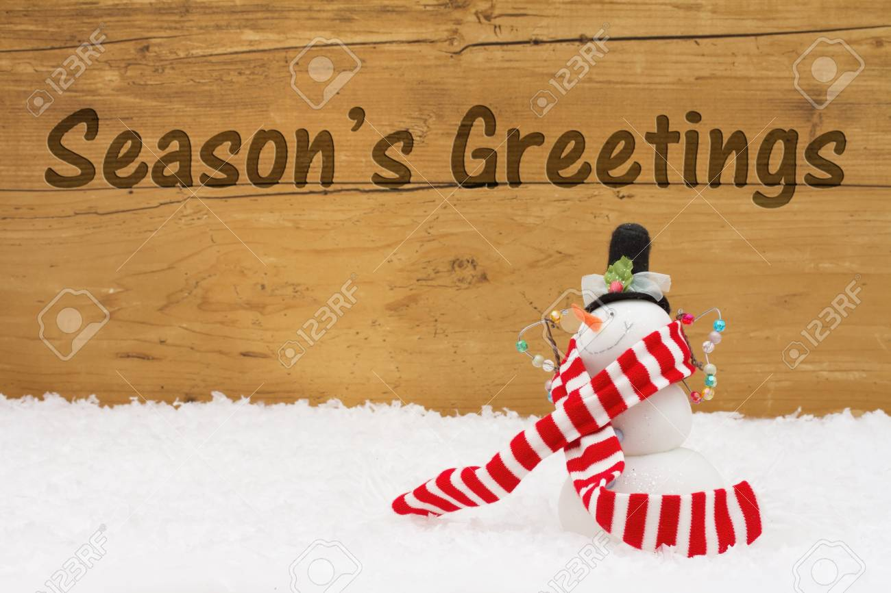 Seasons Greetings Message A Snowman On Snow With A Weathered
