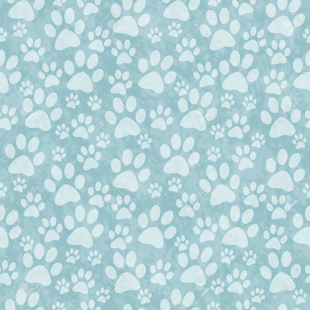 blue dog paw print tile pattern repeat background that is seamless