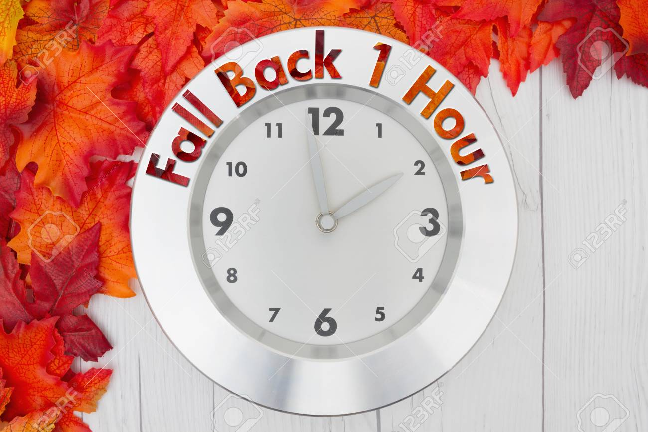 Fall Time Change, Some fall leaves and a clock on weathered wood with text  Fall