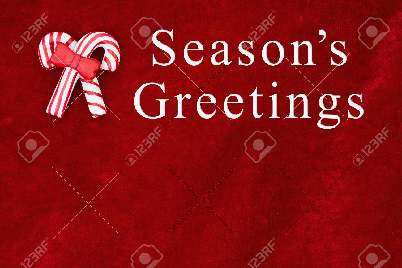 Red Plush Fabric With Two Candy Canes Background With Text Seasons