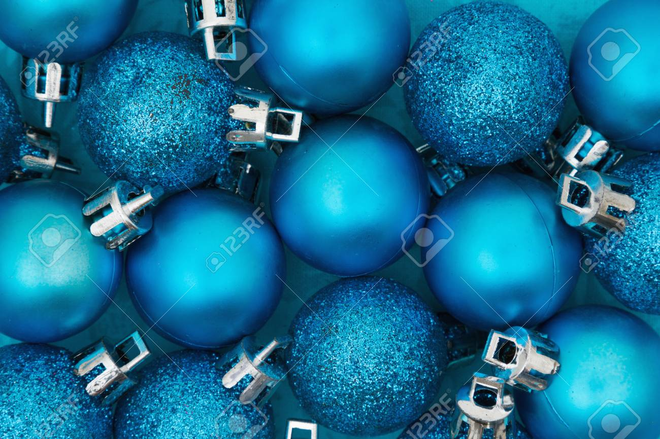 Some Bright Blue Sparkle And Matte Christmas Ball Ornaments Background Stock Photo