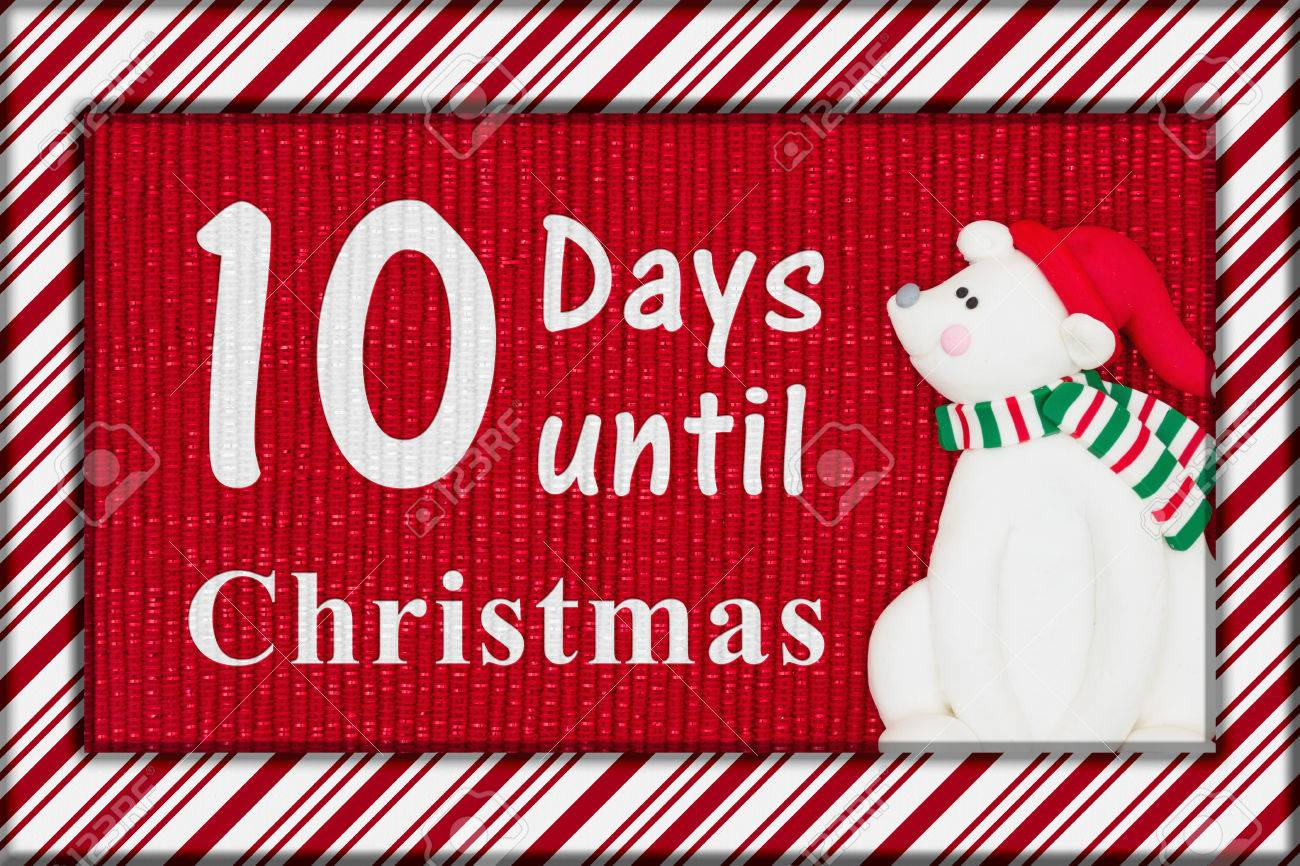 Christmas countdown message, Red shiny fabric with a candy cane border and a Santa polar bear with text 10 days until Christmas - 67107570