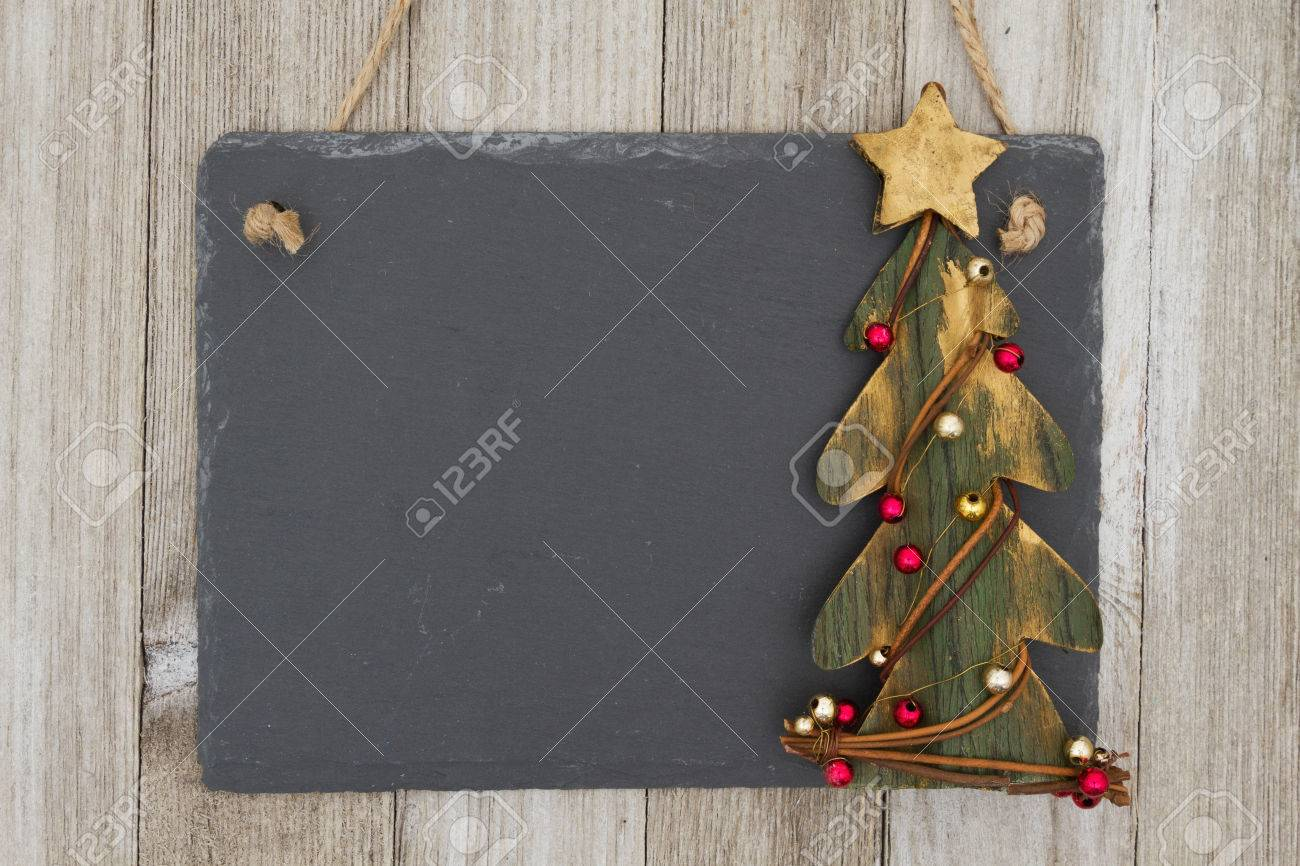 Primitive Christmas Tree.Old Fashion Christmas Hanging Chalkboard Background A Retro
