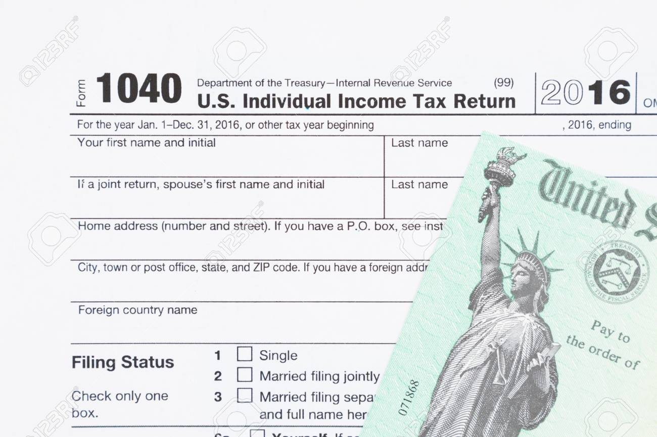 A Us Federal Tax 1040 Income Tax Form With Money And Refund Stock