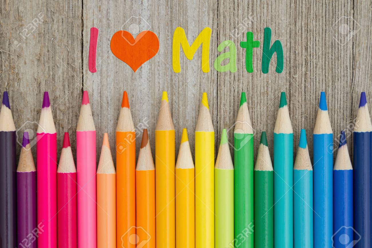 i love math text with colorful pencil crayons on a weathered.. stock