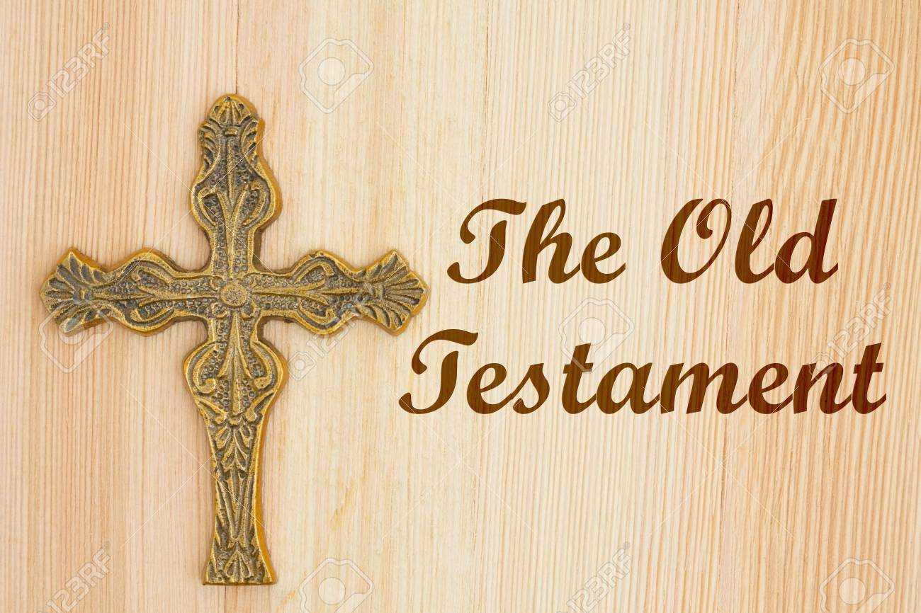 The Old Testament Text With A Gold Detailed Cross On Wood Stock