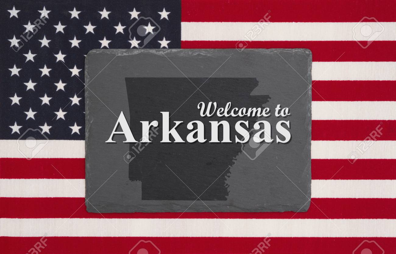 Welcome to Arkansas with state map on a black chalkboard on a..