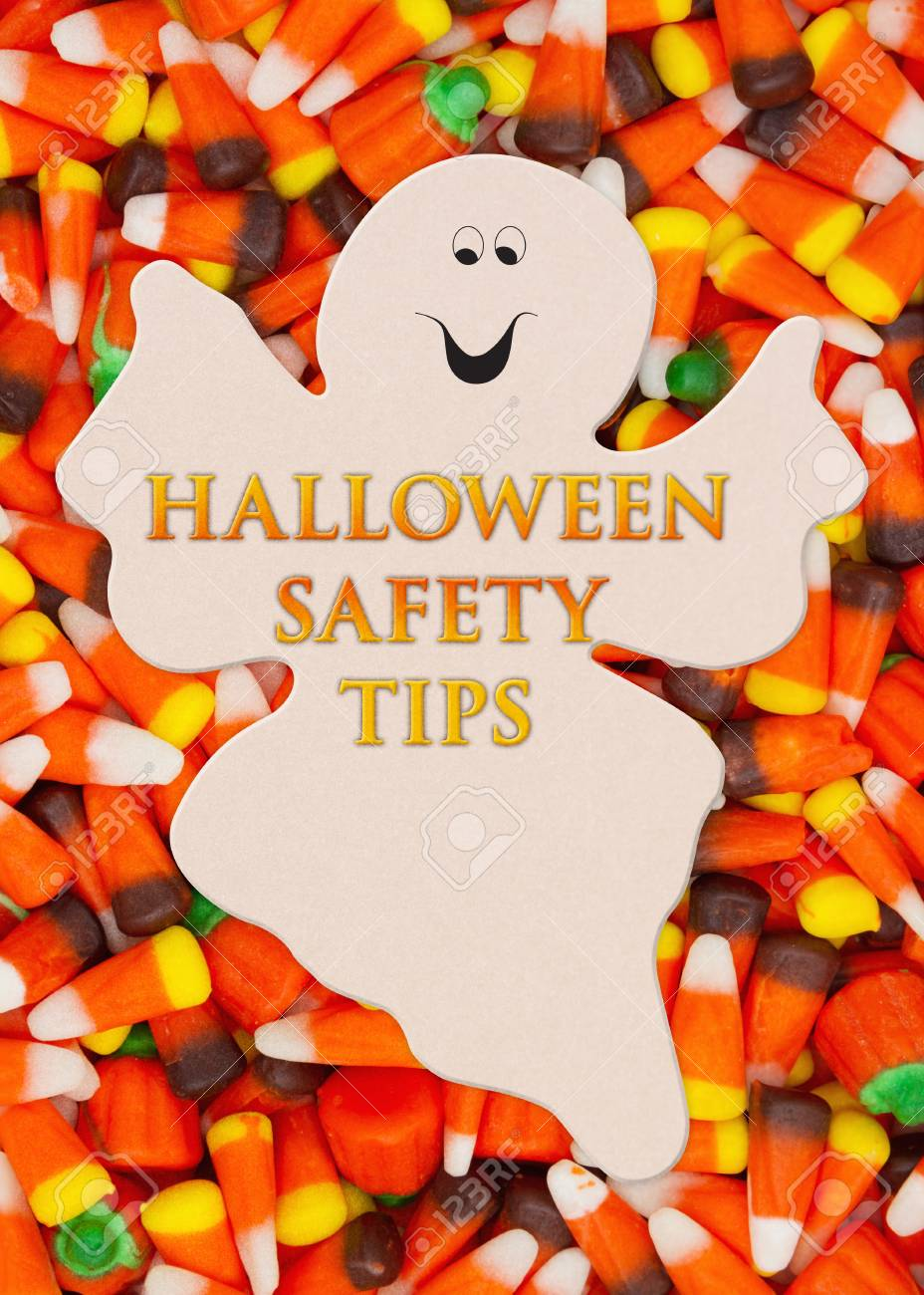 halloween safety tips message with candy corn on a spooky ghost stock photo 99879234