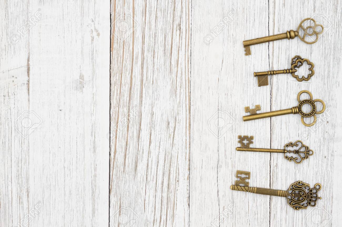 Skeleton keys on weathered whitewash wood background with grain texture with copy space for your security or lock message - 147830345