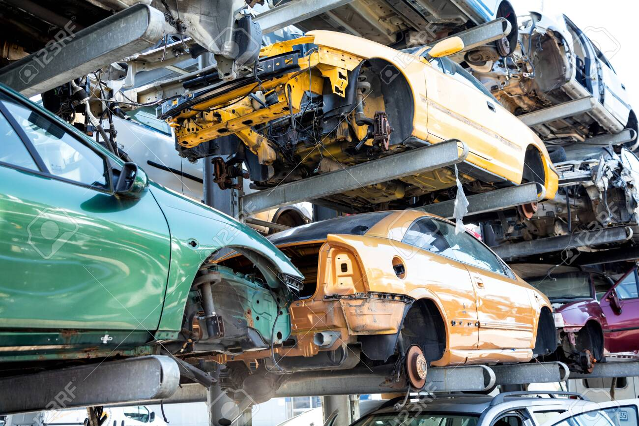 Recycling of old,used, wrecked cars. Dismantling for parts at scrap yards - 150557384