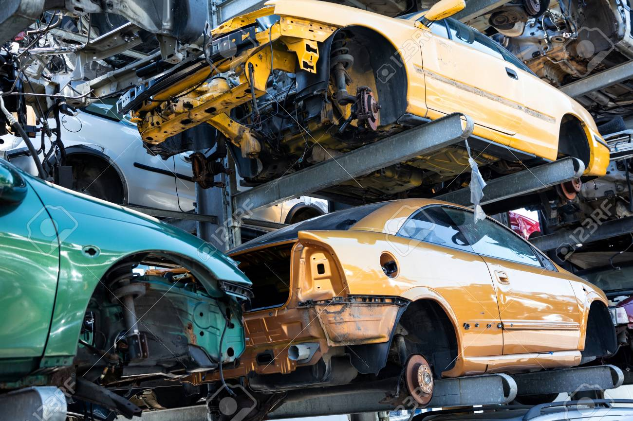 Recycling of old,used, wrecked cars. Dismantling for parts at scrap yards - 112308642