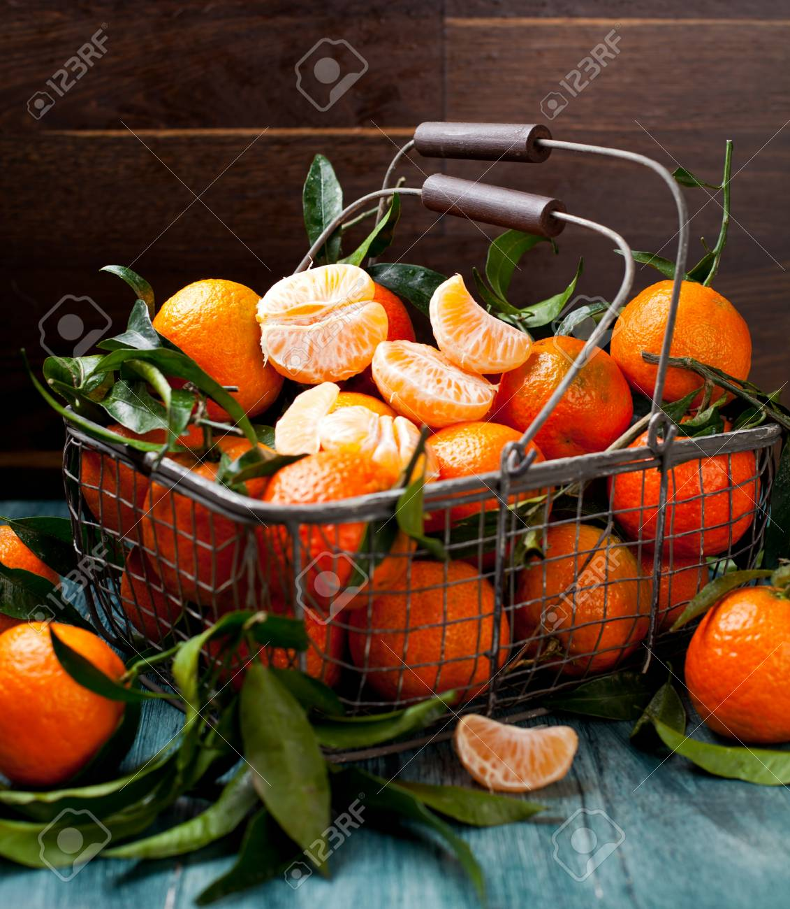 Fresh picked mandarins on wooden background closeup - 113664225