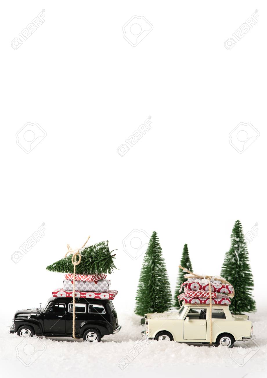 Driving Home For Christmas.Bllack And White Toy Cars With Presents And A Christmas Tree