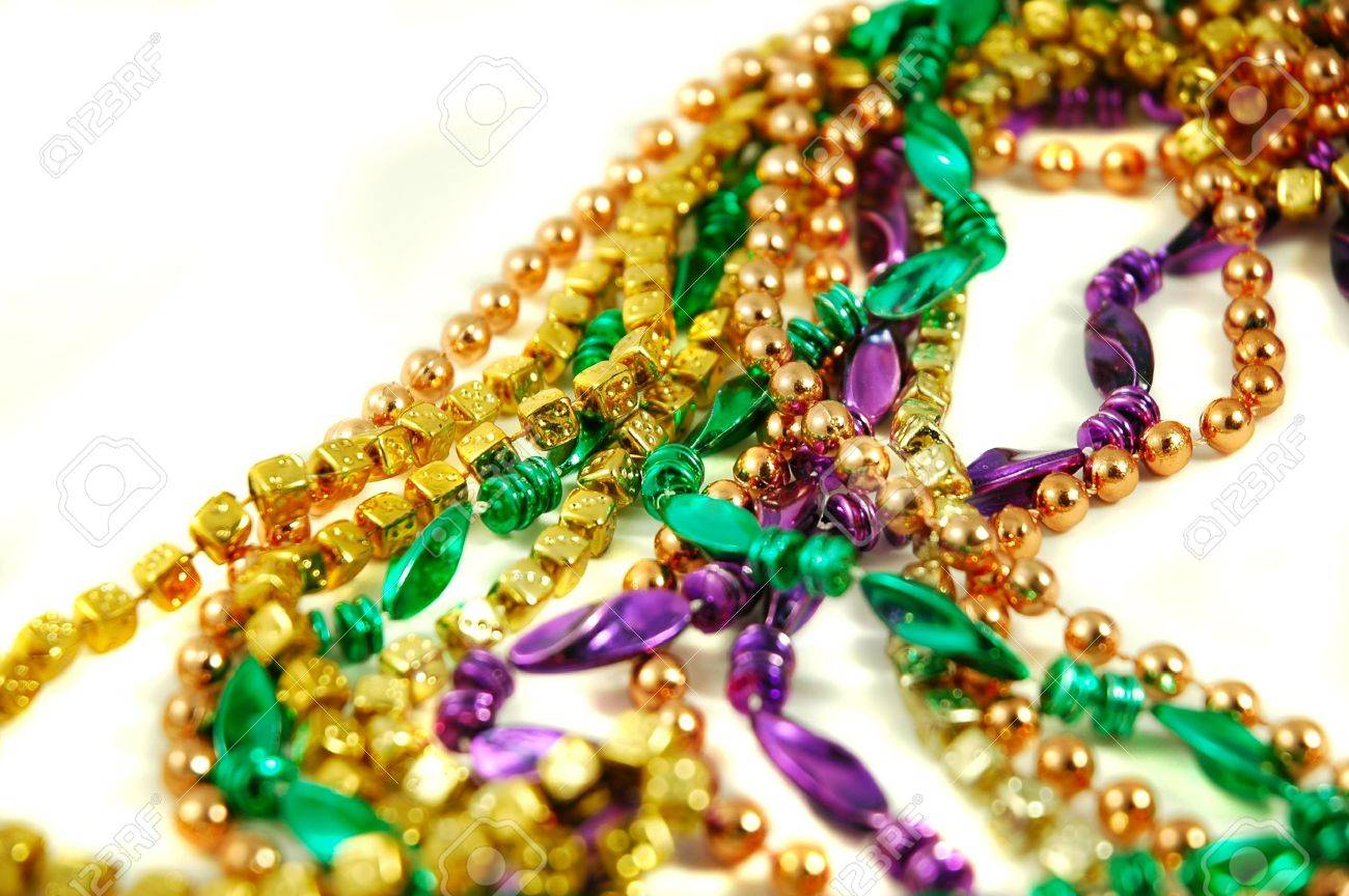 Strands of Mardi Gras beads isolated on a white background Stock Photo - 631436