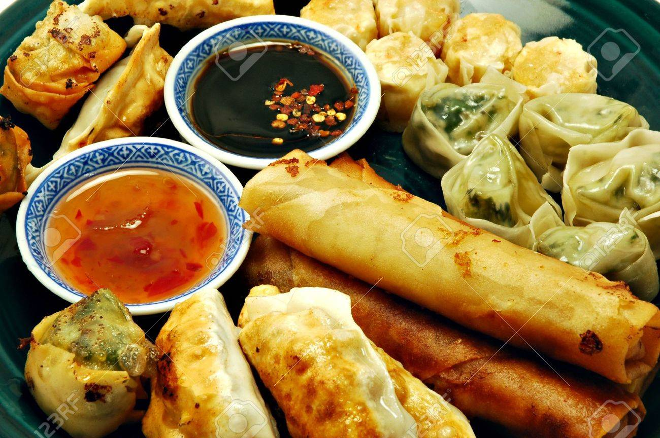 Plate Of Dim Sum, Egg Rolls, Shumai, And Pot Stickers With Dipping ...