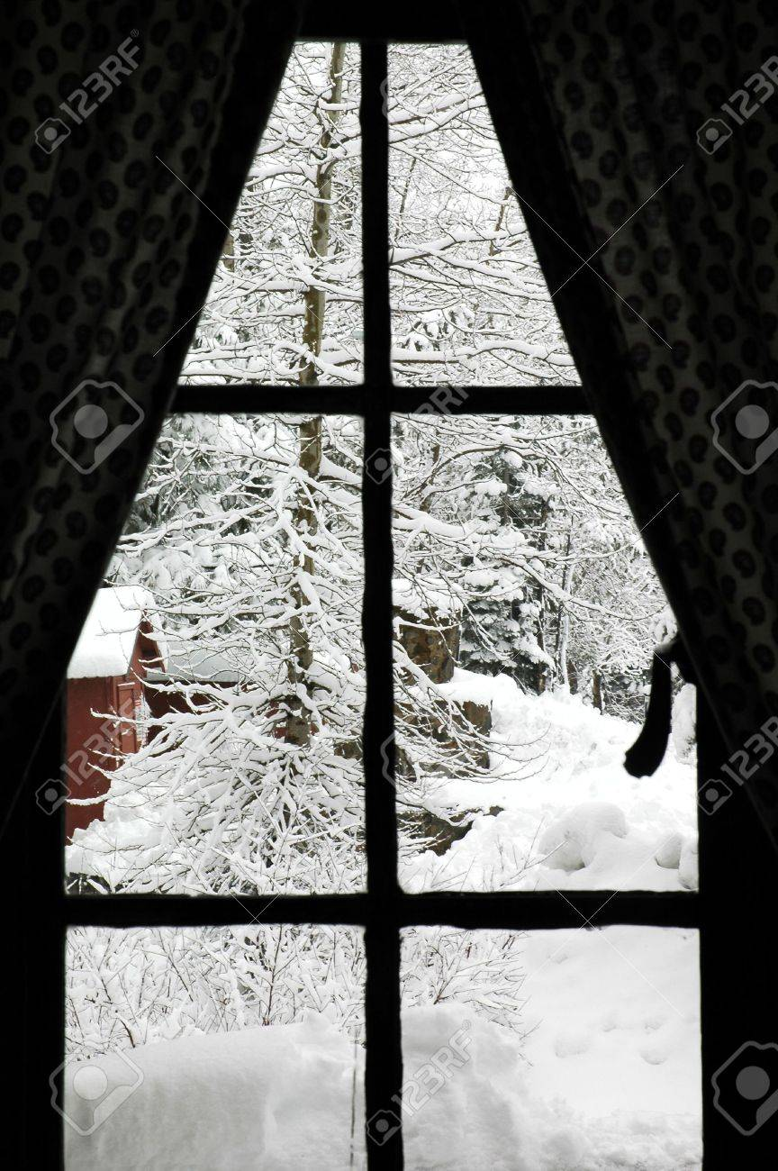 Looking through an old cabin window at freshly fallen snow Stock Photo - 684985