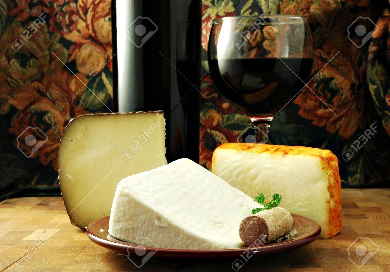 Three cheeses with a bottle and glass of red wine Stock Photo - 760018
