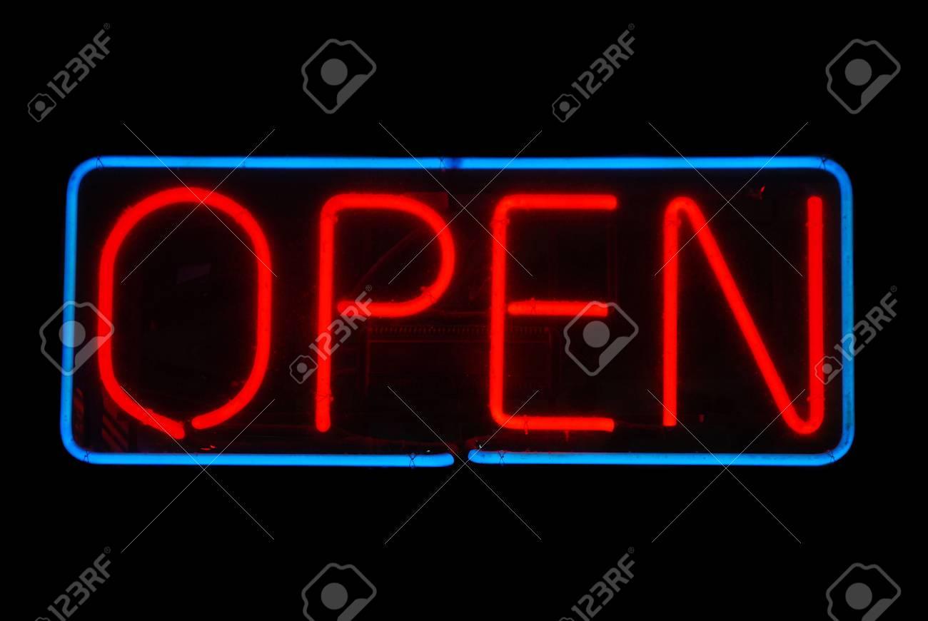 Illuminated open neon sign on black background Stock Photo - 2090284