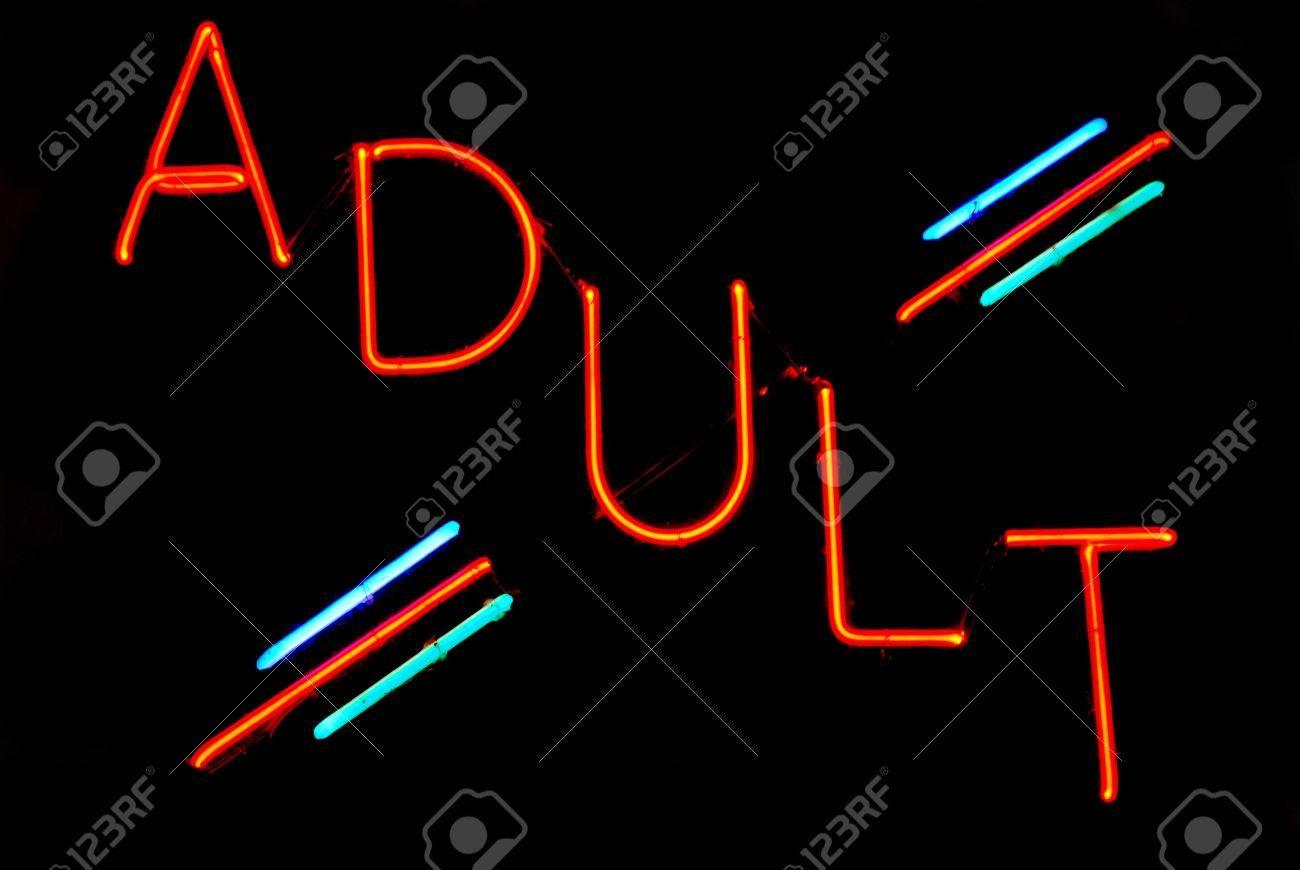 Illuminated adult neon sign on black background Stock Photo - 2090277
